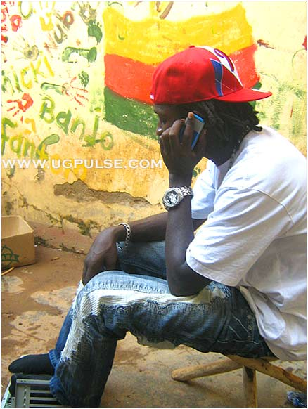 Attending to official business: Bobi Wine takes a call during the interview