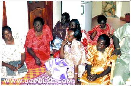 A group of Acholi ladies watch the proceedings at a marriage ceremony
