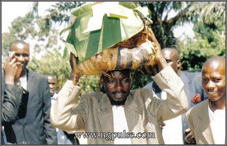 Traditional beer, delivered traditionally, is necessary to oil the proceedings at a traditional marriage ceremony in Busoga.