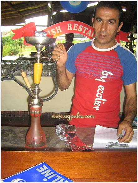Shaida Khurshid demonstrates the use of a shisha
