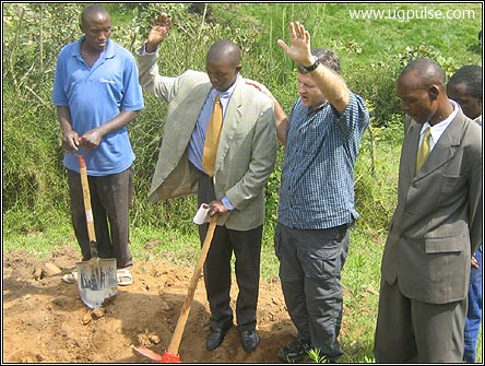 Pastor Pontius prays for the land on which the school is being built