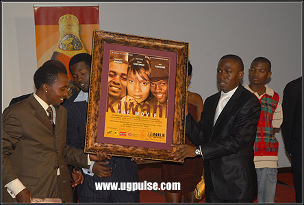 Movie Director Henry Ssali and one of main actors, Hanington Bugingo present an autographed plague for auction at the movie's premier