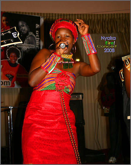 Sarah Ndagire performing at the Nyaka Eire! Concert dressed by Stella Atal