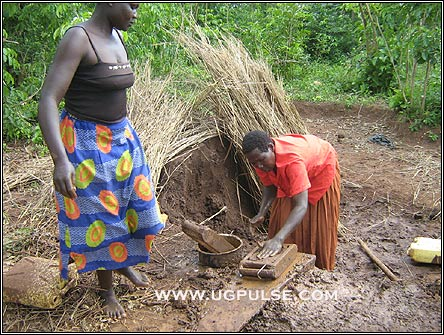 Jacinta Okwer and Judith Okello in Bar Opok village making bricks