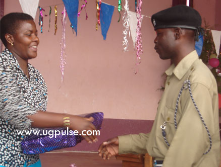 Mbale Assistant Town Clerk Rosemary Mukite hands over a gift to Sabali Opolot