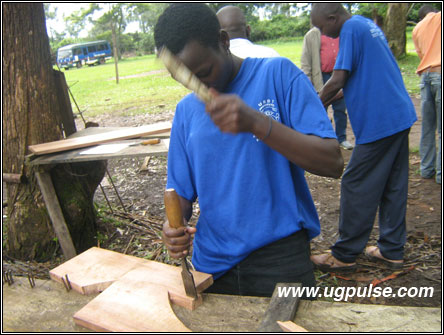 Harriet Nabukenya who studies carpentry and joinery URDT Institute