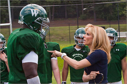 Sandra Bullock as Leigh Anne Tuohy and Quinton Arron as Michael Oher