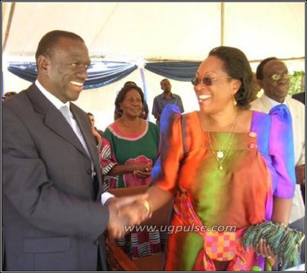 Dr. Besigye with Joyce Sebugwawo