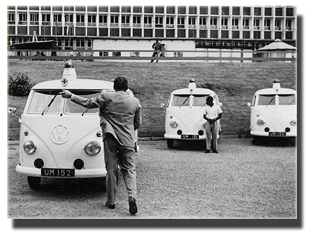 Hubert directing the driver to position the ambulances in front of Parliament building