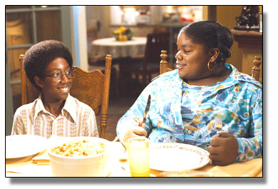 Austin Reid and Lindsey Sims-Lewis as young Norbit and young Rasputia
