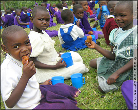 Smiles all round during meal time at Nyaka Aids Orphan School