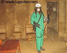 Mosquitoes meet their match; An official sprays a building with ICON, a mosquito terminating chemical
