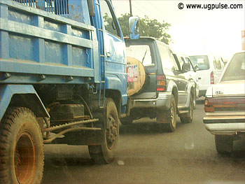Most Ugandan roads are enveloped by dust especially during rush hours