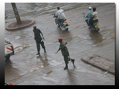 Armed military men on patrol in Kampala