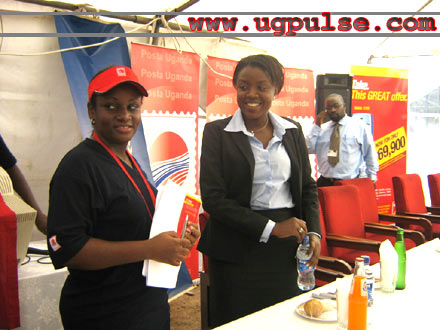 Agatha Mbabazi (centre), Posta's successful customer care guru is all smiles